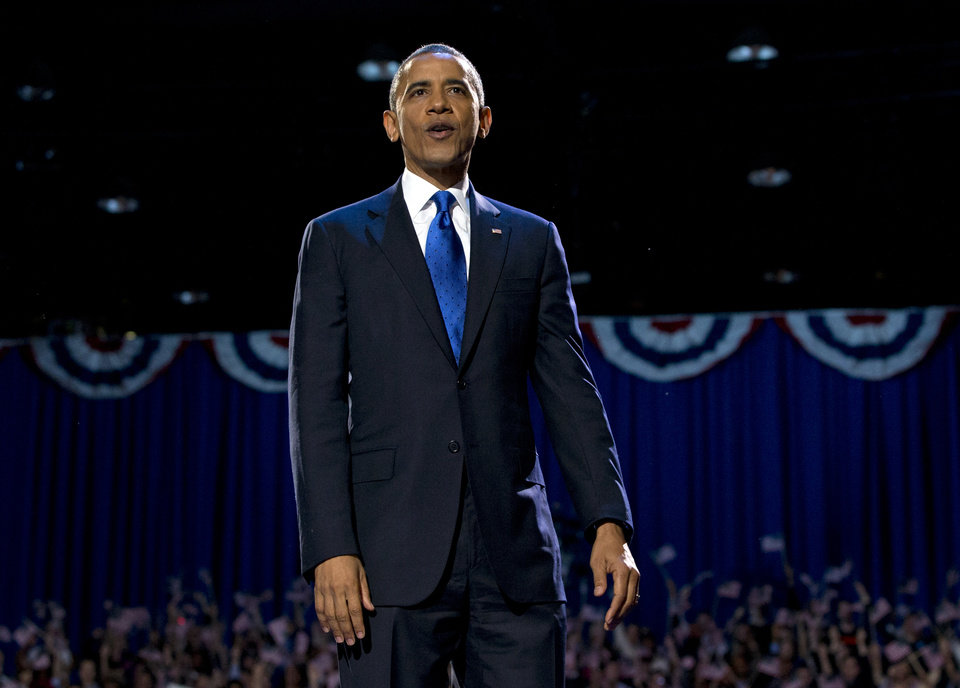 President Barack Obama stands on stage at the election night party Wednesday, Nov. 7, 2012, in Chicago. Obama defeated Republican challenger former Massachusetts Gov. Mitt Romney. (AP Photo/Carolyn Kaster)
