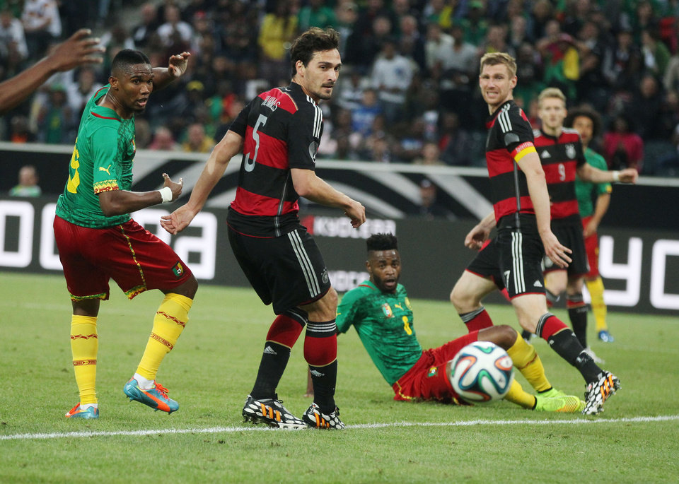 Photo - Cameroon's Samuel Eto'o, left, scores his side's opening goal  during a soccer friendly match between Germany and Cameroon in Moenchengladbach, Germany, Sunday, June 1, 2014. (AP Photo/Michael Probst)