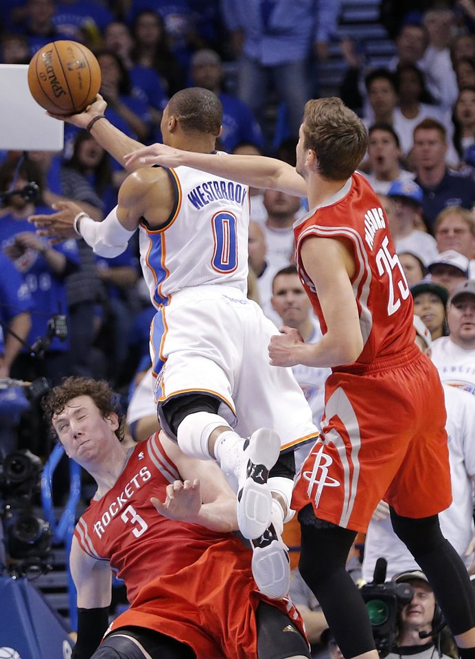 Oklahoma City\'s Russell Westbrook (0) drives past Houston\'s Omer Asik (3) and Chandler Parsons (25) during Game 2 in the first round of the NBA playoffs between the Oklahoma City Thunder and the Houston Rockets at Chesapeake Energy Arena in Oklahoma City, Wednesday, April 24, 2013. Photo by Chris Landsberger, The Oklahoman