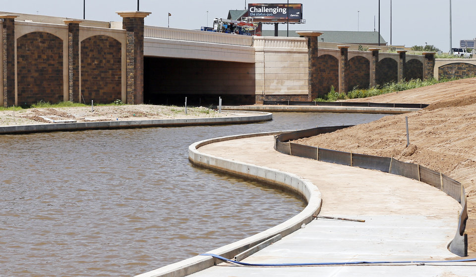 Photo - A view of the new Interstate 40 passing over the canal extension to the  Oklahoma River at he Boathouse District in Oklahoma City, Thursday, June 27, 2013. Photo by Nate Billings, The Oklahoman