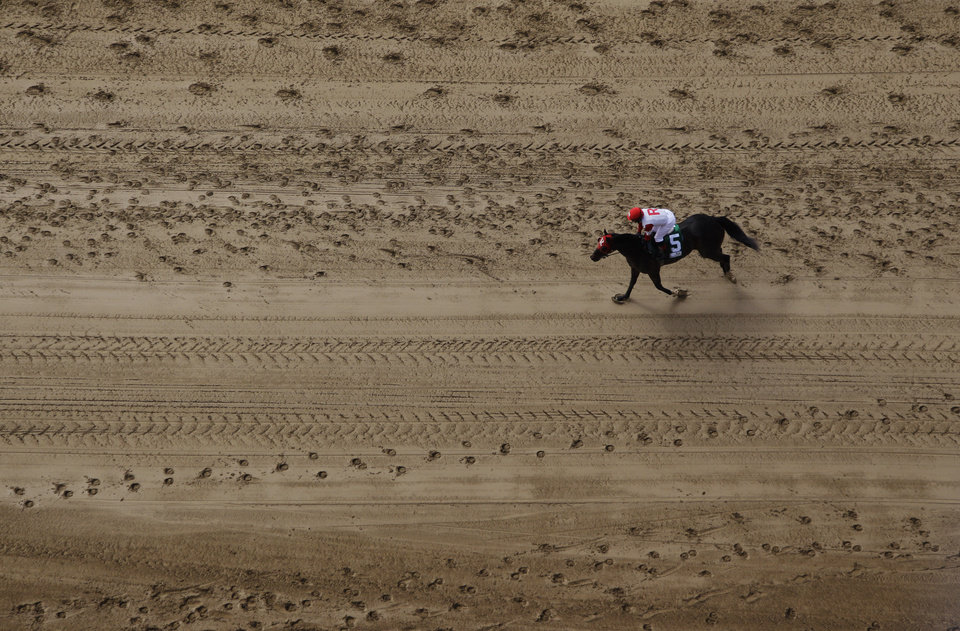 Photo - Jockey Oriana Rossi rides Little Willy back to the paddock after placing second in the first race before the 138th Kentucky Derby horse race at Churchill Downs Saturday, May 5, 2012, in Louisville, Ky. (AP Photo/Charlie Riedel)  ORG XMIT: DBY121