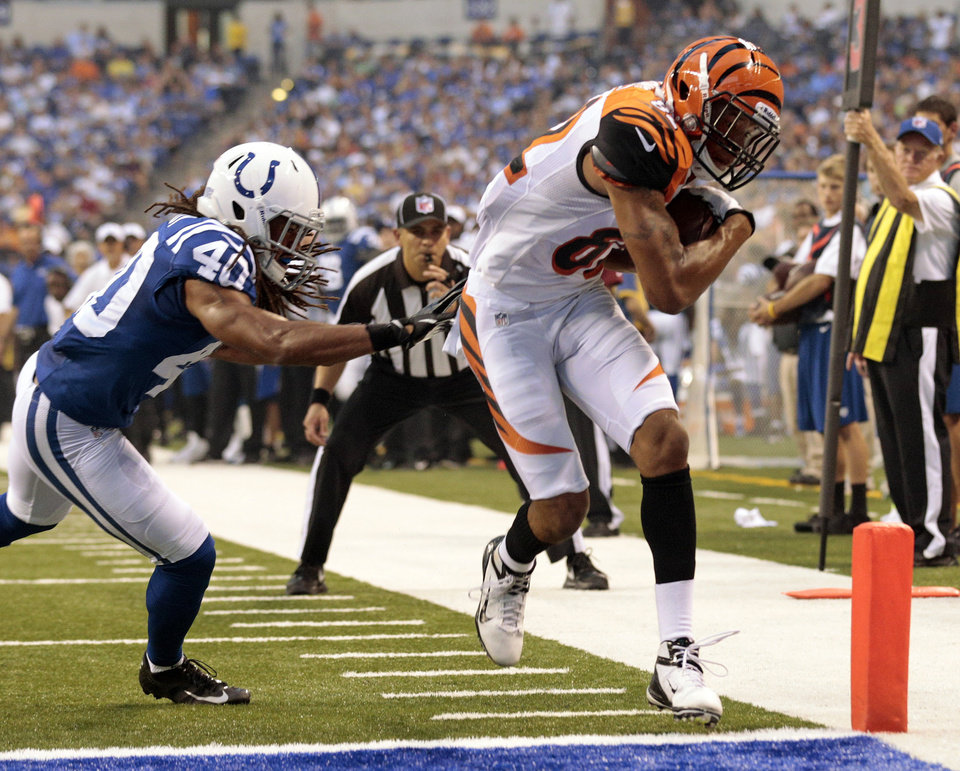 Photo -   Cincinnati Bengals wide receiver Marvin Jones, right, scores in front of Indianapolis Colts cornerback Josh Gordy in the first half of an NFL preseason football game in Indianapolis, Thursday, Aug. 30, 2012. (AP Photo/AJ Mast)