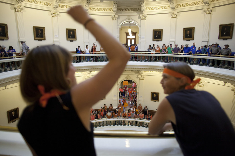 Hallie Boas and Lisa Fithian lead abortion rights chants from the third floor of the Texas Capitol Rotunda in Austin, Texas on Friday, July 12, 2013. The Texas Senate\'s leader, Lt. Gov. David Dewhurst, has scheduled a vote for Friday on the same restrictions on when, where and how women may obtain abortions in Texas that failed to become law after a Democratic filibuster and raucous protesters were able to run out the clock on an earlier special session. (AP Photo/Tamir Kalifa)