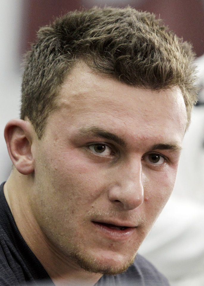 Photo - Texas A&M quarterback Johnny Manziel talks to members of the media during pro day for NFL football representativesin College Station, Texas, Thursday, March 27, 2014. (AP Photo/Patric Schneider)