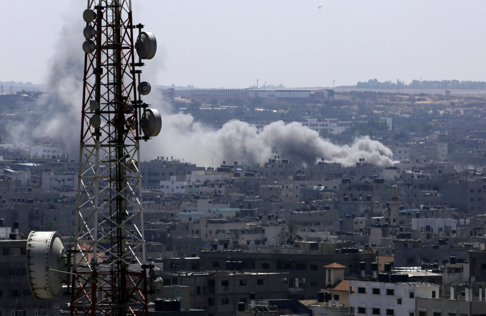 Photo - Smoke and dust rise after an Israeli strike hits in Gaza City, northern Gaza Strip, Tuesday, Aug. 26, 2014. The latest strikes came as Egypt urged Israel and Hamas to resume indirect talks on a permanent cease-fire, based on an Egyptian proposal for a new border deal for blockaded Gaza. (AP Photo/Adel Hana)
