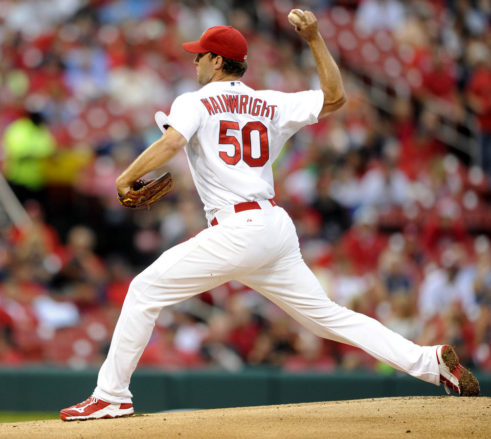 Photo - St. Louis Cardinals' starting pitcher Adam Wainwright (50) throws against the Boston Red Sox in the first inning in a baseball game, Thursday, Aug. 7, 2014, at Busch Stadium in St. Louis. (AP Photo/Bill Boyce)