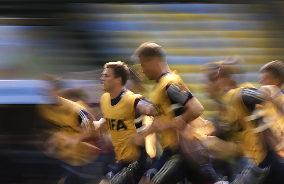 Photo - Maksim Kanunnikov, second left, of Russia's soccer team runs during a training session at the Maracana Stadium in Rio de Janeiro, Brazil, Saturday, June 21, 2014. Russia will play its next game against Belgium in group H of the 2014 soccer World Cup. (AP Photo/Wong Maye-E)