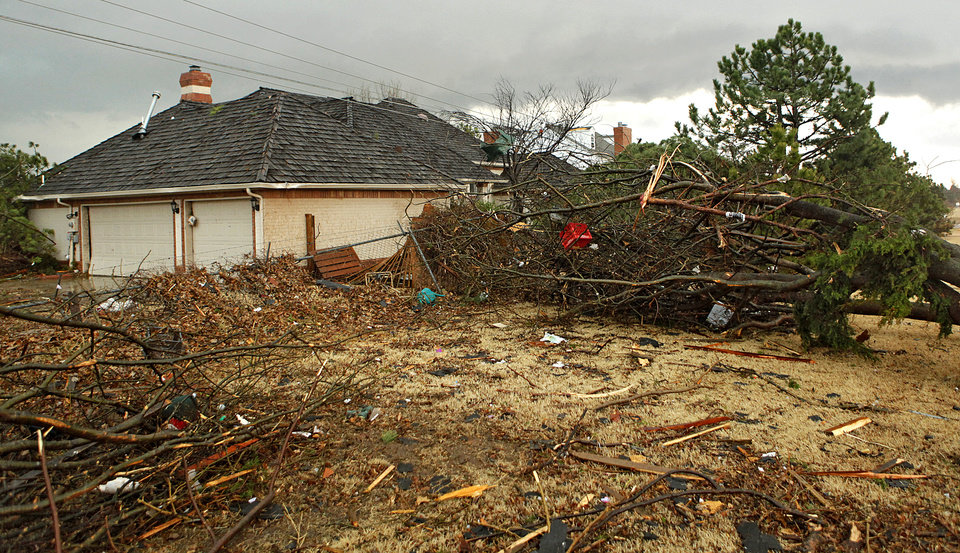 Photo - Storm damage at a home in the Oaktree addition after storms hit the area on Tuesday, Feb. 10, 2009, in Edmond, Okla.  PHOTO BY CHRIS LANDSBERGER, THE OKLAHOMAN
