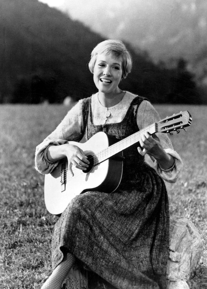 Photo - FILE - This file photo shows Julie Andrews bringing music to the hills of Austria in this scene from