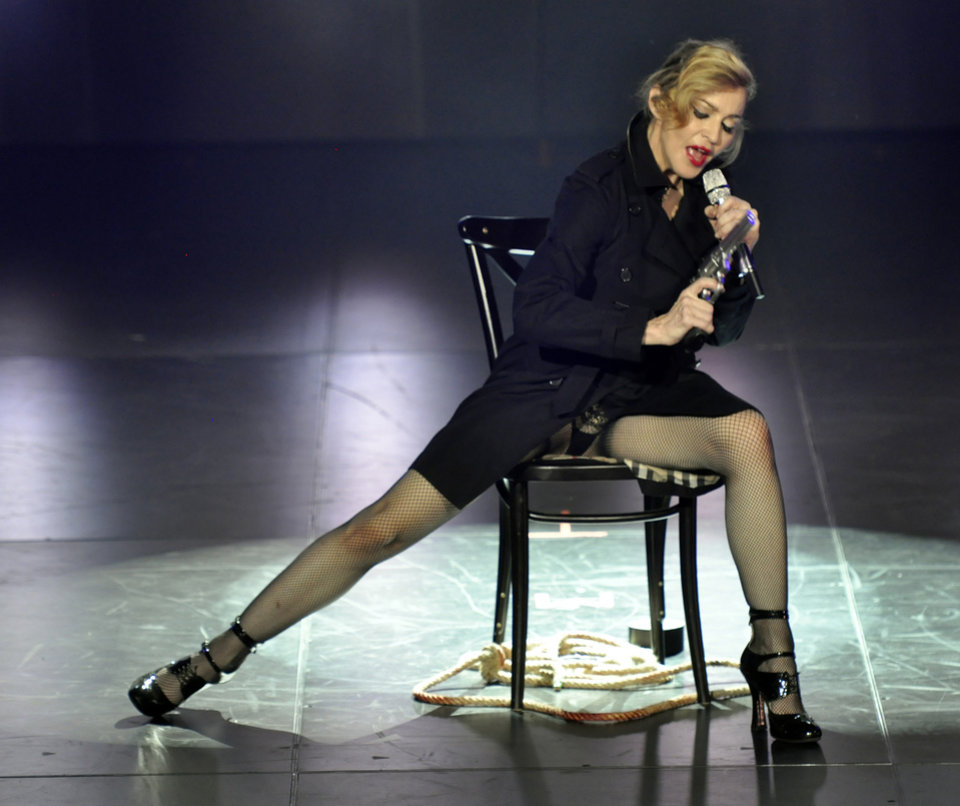 Photo -   In this photo provided by Guy Oseary, Madonna performs on stage during her MDNA concert at Olympia Hall in Paris on Thursday, July 26, 2012. (AP Photo/Guy Oseary)