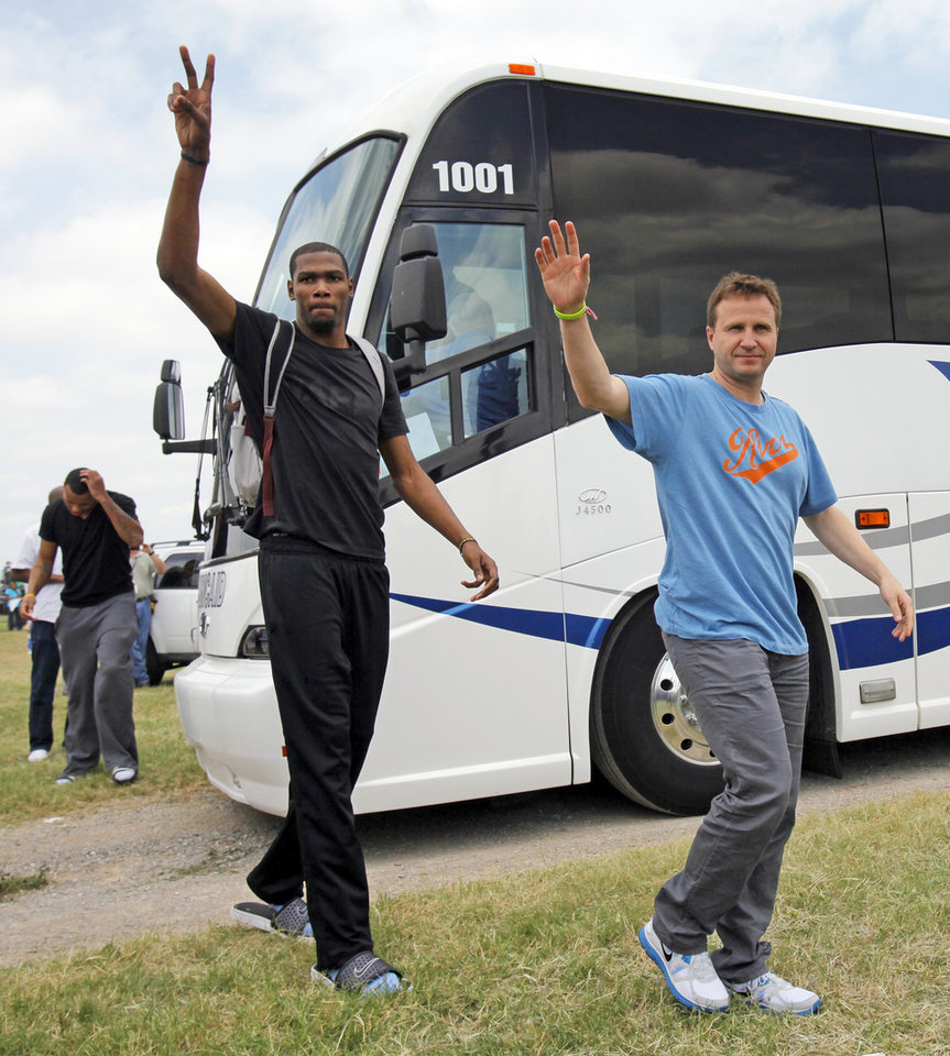 Kevin Durant, left, and head coach Scott Brooks arrive at a welcome home rally for the Oklahoma City Thunder in a field at Will Rogers World Airport after the team\'s loss to the Miami Heat in the NBA Finals, Friday, June 22, 2012. Photo by Nate Billings, The Oklahoman