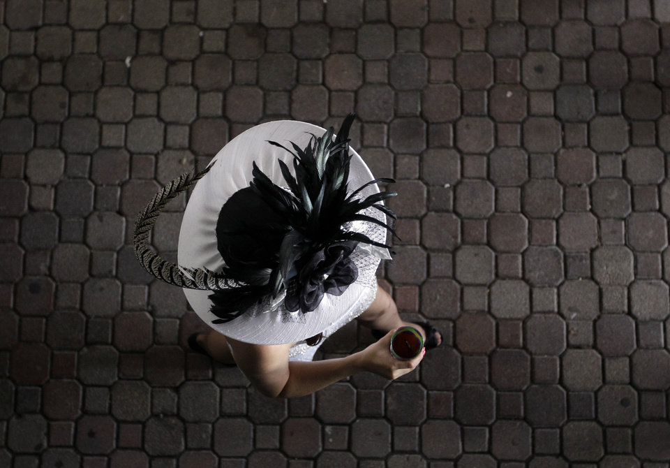 Photo - A spectator walks to the grand stands before the 138th Kentucky Derby horse race at Churchill Downs Saturday, May 5, 2012, in Louisville, Ky. (AP Photo/Matt Slocum)  ORG XMIT: DBY162