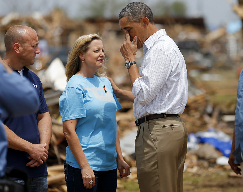 President Barack Obama wipes his eye as he talks with Plaza Towers Elementary Principal Amy Simpson outside the school in Moore, Okla., Sunday, May 26, 2013. President Obama toured the area in Moore that was hit by a tornado on May, 20, 2013. Photo by Bryan Terry, The Oklahoman ORG XMIT: OKC1305261411038212