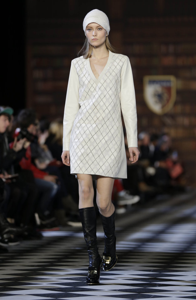 Photo - The Tommy Hilfiger Fall 2013 collection is modeled during Fashion Week in New York, Sunday, Feb. 10, 2013.  (AP Photo/Seth Wenig)