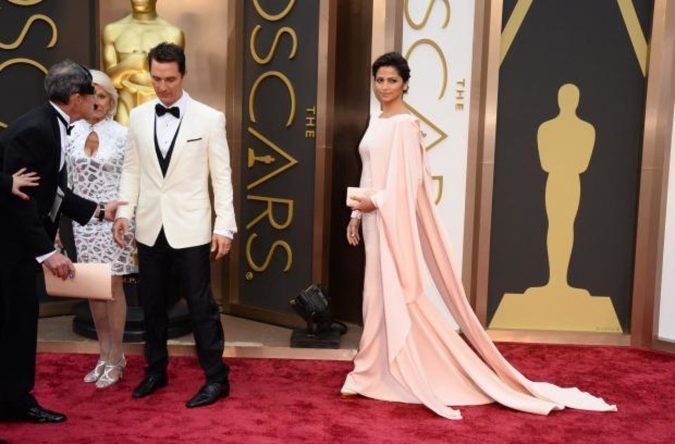 Photo -  Matthew McConaughey, center, arrives with his mom, Kay, left, and wife Camila Alves. (AP)