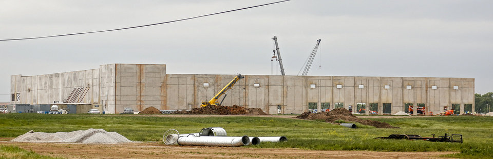 Photo -  Work is underway to build an Amazon sorting center at SW 15 and Council Road in Oklahoma City. [Photos by Chris Landsberger, The Oklahoman]