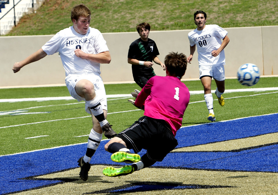 Edmond North's Sam Brown scores the go ahead and ultimatly winning goal past goalie Daniel Taylor in the Class 6A boys state soccer championship game between Edmond North and Norman North on Saturday, May 11, 2013 in Noble, Okla.  Photo by Steve Sisney, The Oklahoman