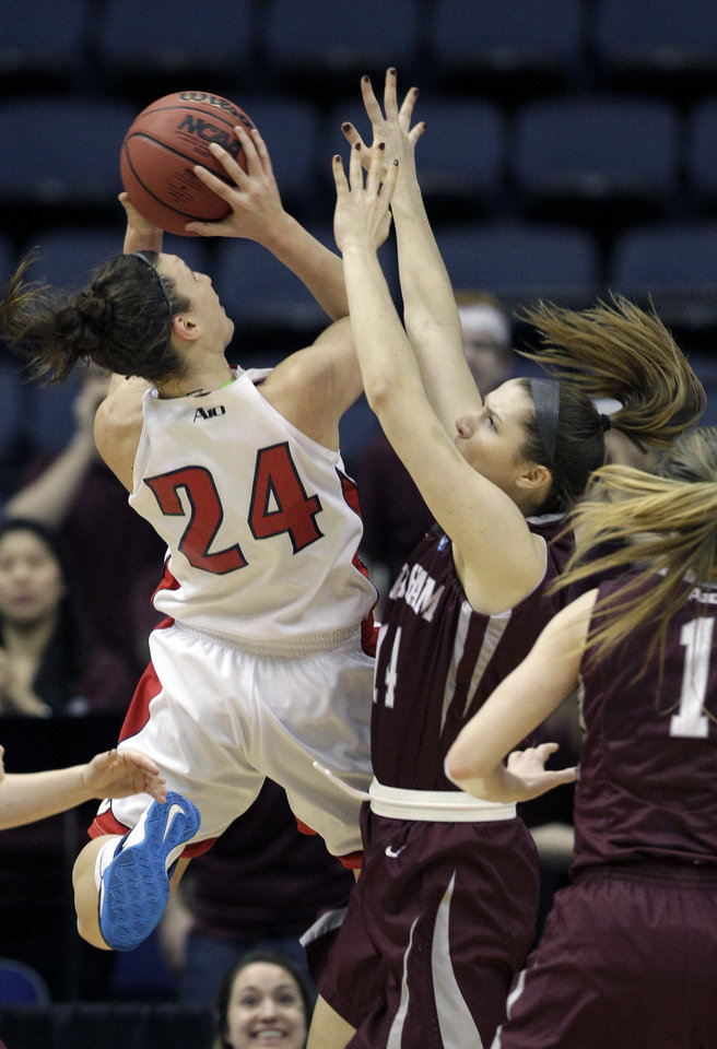 Photo - Dayton guard Andrea Hoover (24) shoots over Fordham forward Danielle Padovano during the first half of the Atlantic 10 Conference college basketball championship game in Richmond, Va., Sunday, March 9, 2014. (AP Photo/Steve Helber)