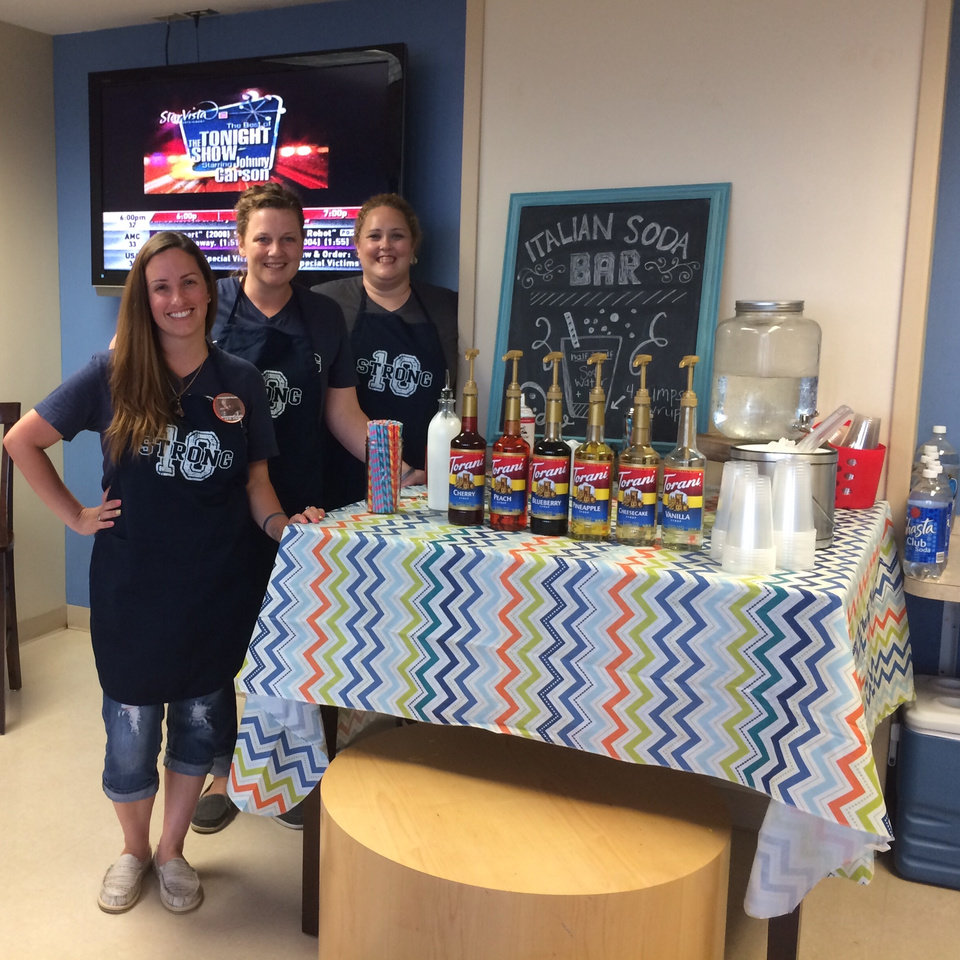 Photo -  From left, Nicole Howard, Beth McDowell and Jordan Keith pose during a 10 Strong Italian Soda Party for children in treatment for cancer and their families at The Children's Hospital at OU Medical Center. [Photo provided]