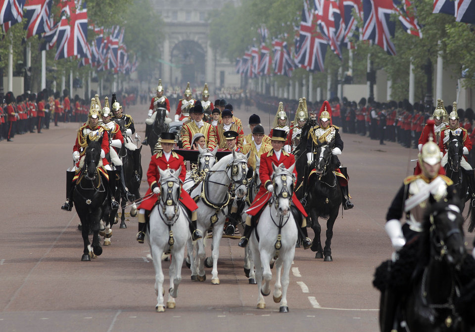 Photo - Britain's Prince William and his wife Kate, Duchess of Cambridge make their way to Buckingham Palace after the Royal Wedding in London Friday, April, 29, 2011. (AP Photo/Lefteris Pitarakis) ORG XMIT: RWMG169