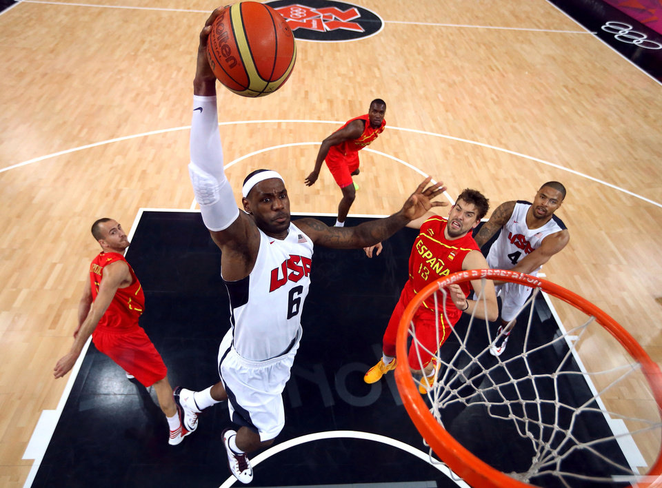 United States'  LeBron James (6) dunks against Spain during the men's gold medal basketball game at the 2012 Summer Olympics  in London on Sunday, Aug. 12, 2012. (AP Photo/Christian Petersen, Pool)