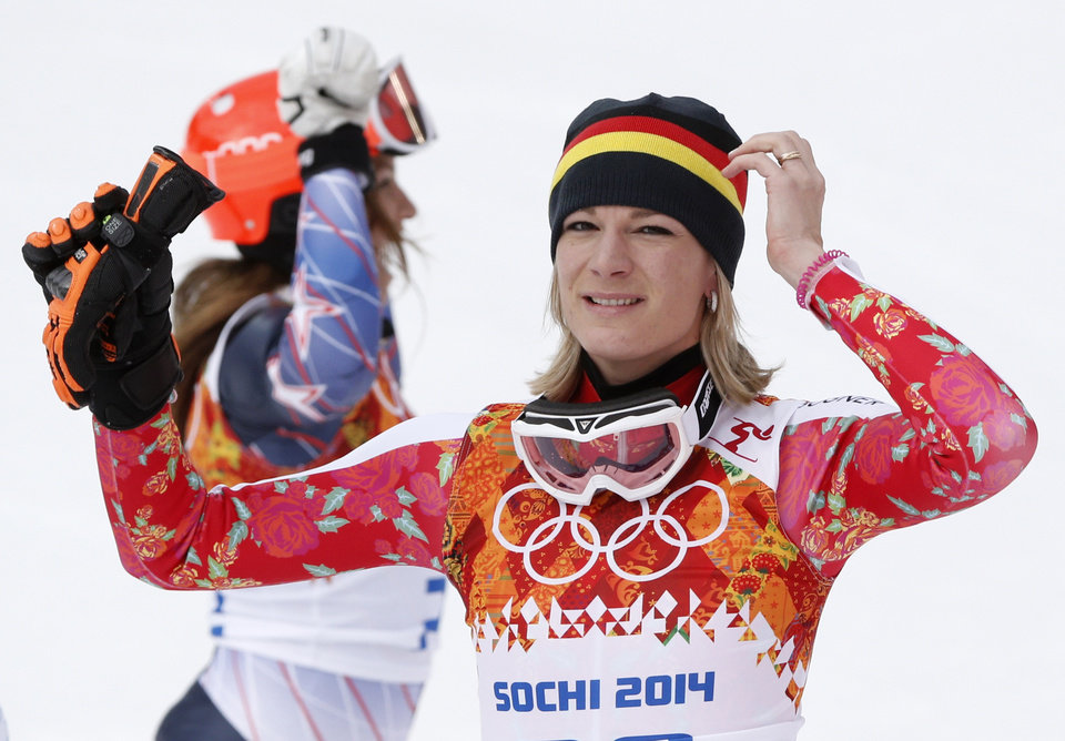 Photo - Germany's Maria Hoefl-Riesch reacts after winning the gold medal in the women's supercombined at the Sochi 2014 Winter Olympics, Monday, Feb. 10, 2014, in Krasnaya Polyana, Russia. (AP Photo/Christophe Ena)