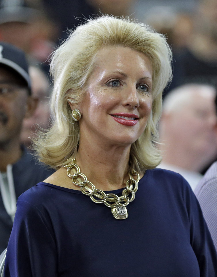Photo - New York Yankees general partner and vice-chairperson Jennifer Steinbrenner-Swindal smiles as shortstop Derek Jeter speaks during a news conference Wednesday, Feb. 19, 2014, in Tampa, Fla. Jeter has announced he will retire at the end of the 2014 season. (AP Photo/Chris O'Meara)