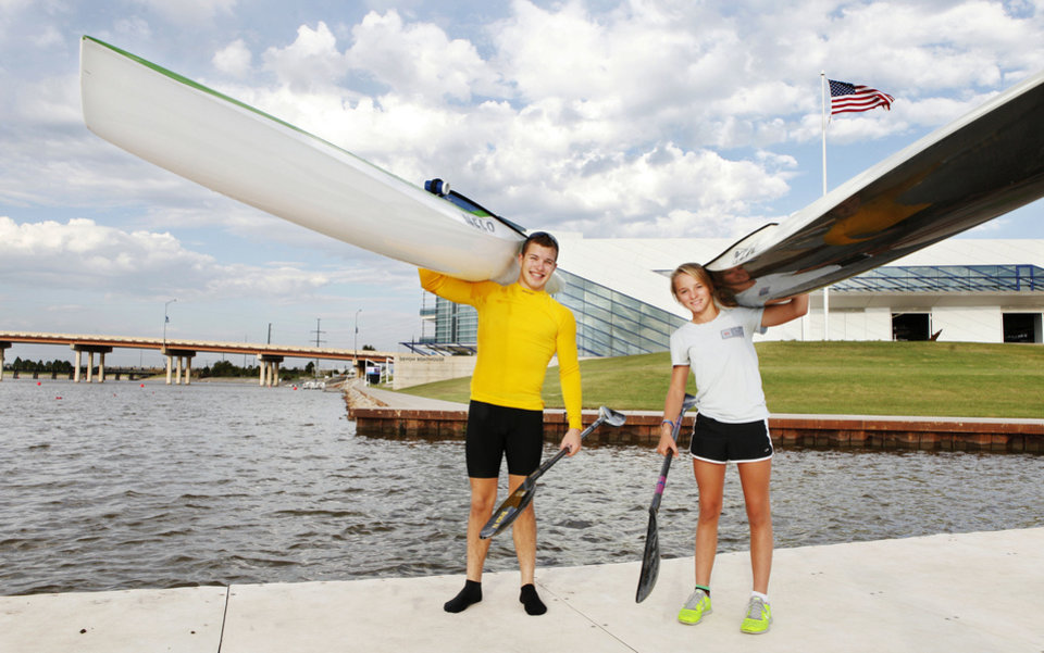 Photo - Oklahoma Riversport Junior Sprint Canoe/Kayak competitors Dylan Puckett, 16, and Bria Cornforth, 12, on the Oklahoma River at the Devon Boathouse in Oklahoma City Wednesday, Sept. 26, 2012. Photo by Paul B. Southerland, The Oklahoman  PAUL B. SOUTHERLAND - PAUL B. SOUTHERLAND