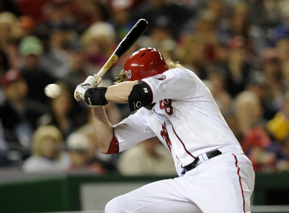 Photo - Washington Nationals' Jayson Werth reacts after he was hit by a pitch by Los Angeles Angels starting pitcher Garrett Richards, not seen, during the fourth inning of a baseball game, Monday, April 21, 2014, in Washington. (AP Photo/Nick Wass)
