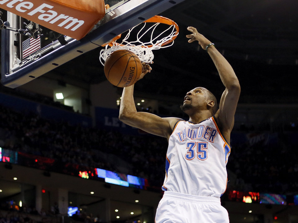 Oklahoma City\'s Kevin Durant (35) dunks the ball during an NBA basketball game between the New York Knicks and the Oklahoma City Thunder at Chesapeake Energy Arena in Oklahoma City, Sunday, Feb. 9, 2014. Photo by Nate Billings, The Oklahoman