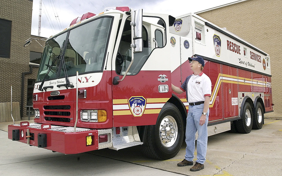 Photo -  Retired Oklahoma City Assistant Fire Chief Jon Hansen with a rescue unit paid for by Oklahoma schoolchildren under the Spirit of Oklahoma Challenge in 2011. [PHOTO PROVIDED]