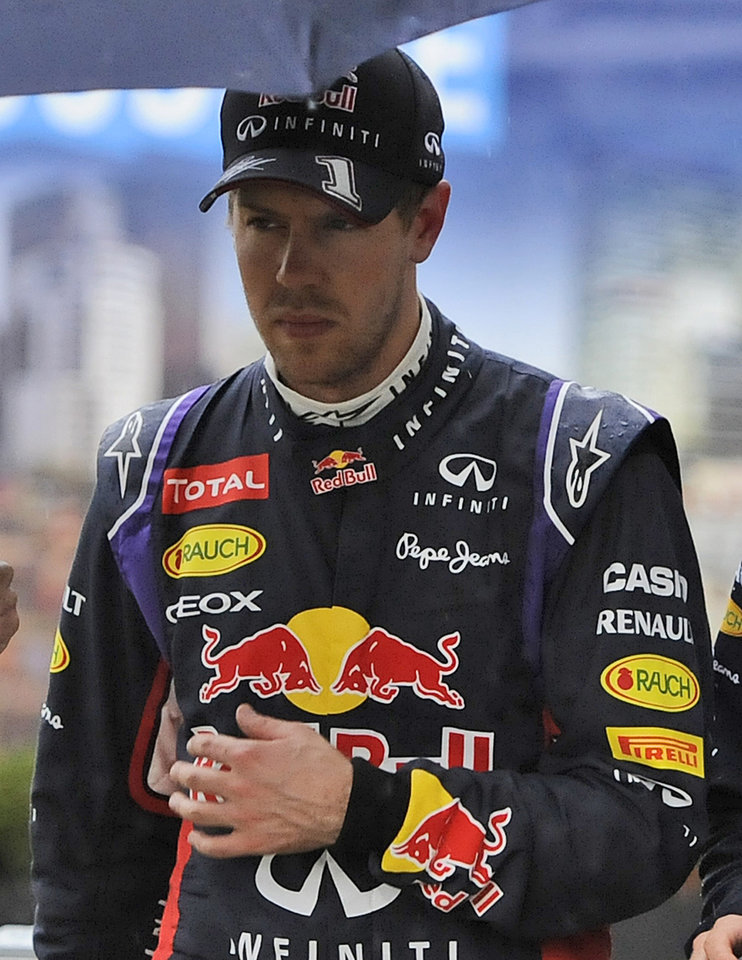 Photo - Red Bull driver Sebastian Vettel of Germany leaves the FIA office after an on track incident with Ferrari driver Kimi Raikkonen of Finland during qualifying at Albert Park ahead of the Australian Formula One Grand Prix in Melbourne, Australia, Saturday, March 15, 2014. (AP Photo/Ross Land)