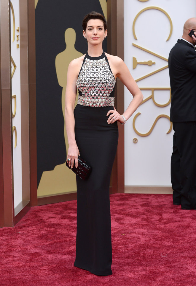 Photo - Anne Hathaway arrives at the Oscars on Sunday, March 2, 2014, at the Dolby Theatre in Los Angeles.  (Photo by Jordan Strauss/Invision/AP)