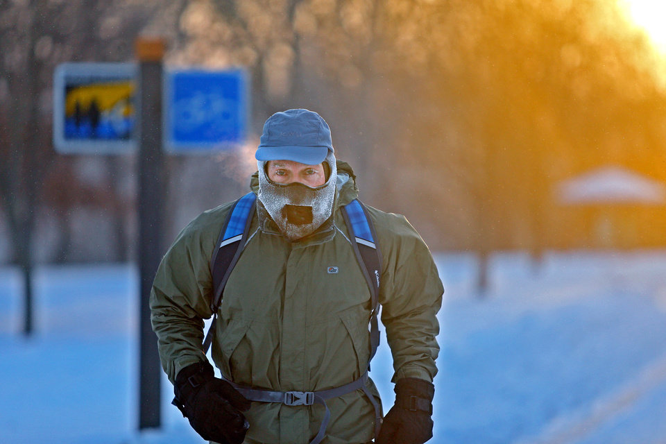 Photo - John Brower braves the frigid -20 weather to run to work at sunrise along West River Parkway, Monday, Jan. 6, 2014, in Minneapolis. (AP Photo/The Star Tribune, Elizabeth Flores)  MANDATORY CREDIT; ST. PAUL PIONEER PRESS OUT; MAGS OUT; TWIN CITIES TV OUT