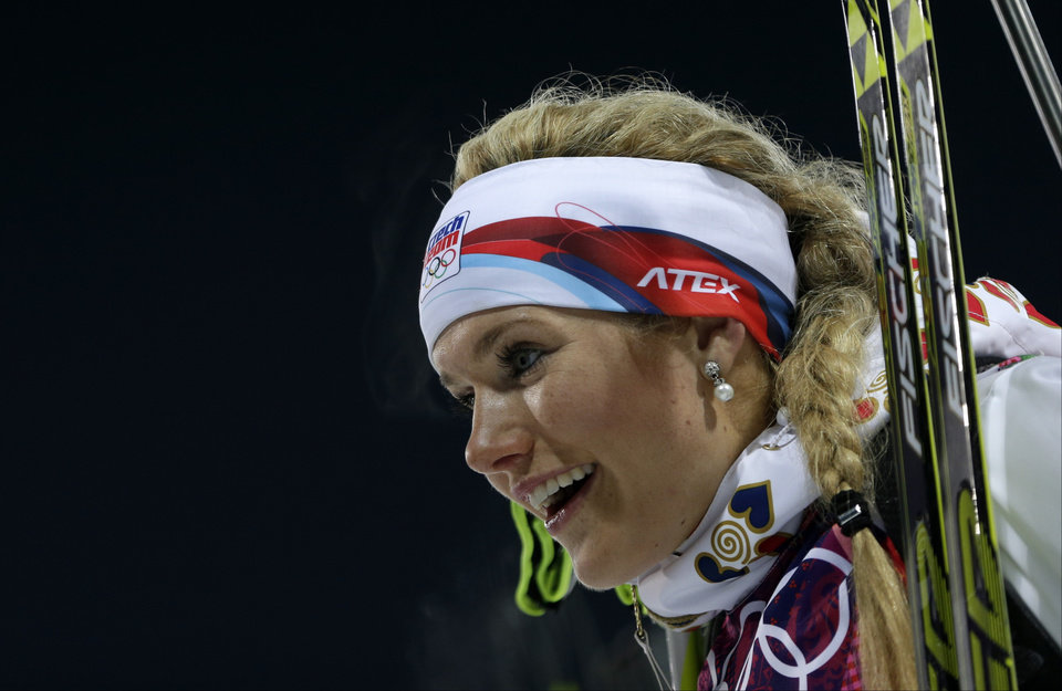 Photo - Silver medalist Czech Republic's Gabriela Soukalova smiles after completing the women's biathlon 12.5k mass-start, at the 2014 Winter Olympics, Monday, Feb. 17, 2014, in Krasnaya Polyana, Russia. (AP Photo/Felipe Dana)