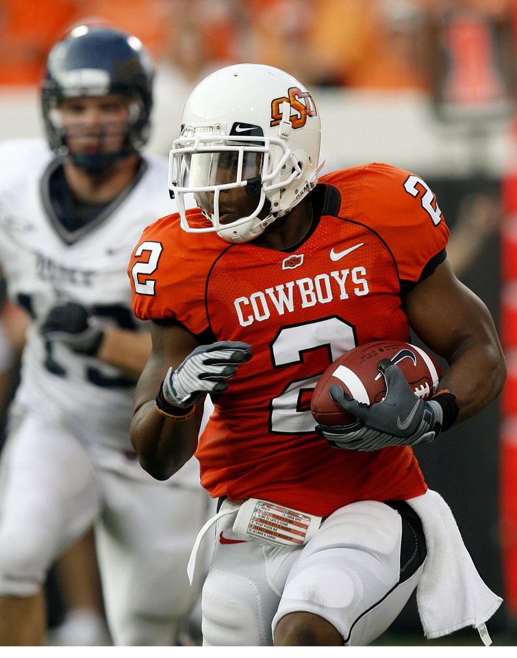 Photo - OSU's Beau Johnson (2) rushes at the college football game between Oklahoma State University (OSU) and Rice University at Boone Pickens Stadium in Stillwater, Okla., Saturday, Sept. 19, 2009. Photo by Sarah Phipps, The Oklahoman ORG XMIT: KOD