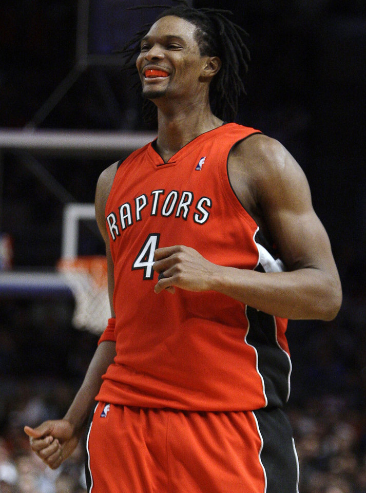 Photo - REACTION: Toronto Raptors' Chris Bosh reacts after scoring against the New York Knicks with just seconds left in an NBA basketball game Thursday, Jan. 28, 2010, at Madison Square Garden in New York. The Raptors won 106-104. (AP Photo/Julie Jacobson) ORG XMIT: NYJJ109
