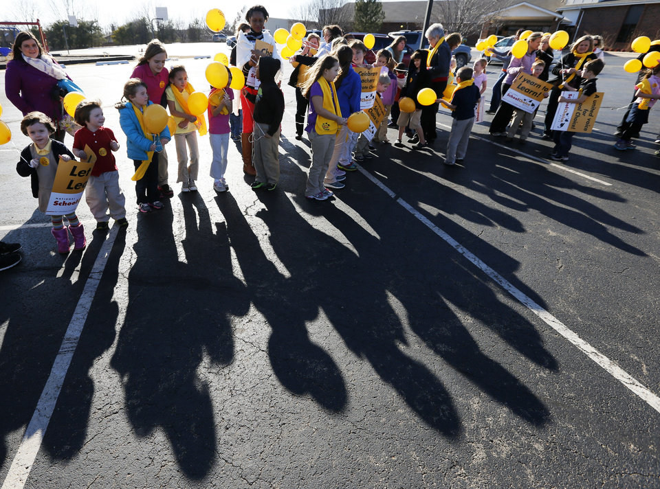 Photo - Students, teachers and parents line up before releasing balloons at Sunnybrook Christian School as part of National School Choice Week. Photo by Nate Billings, The Oklahoman  NATE BILLINGS - NATE BILLINGS
