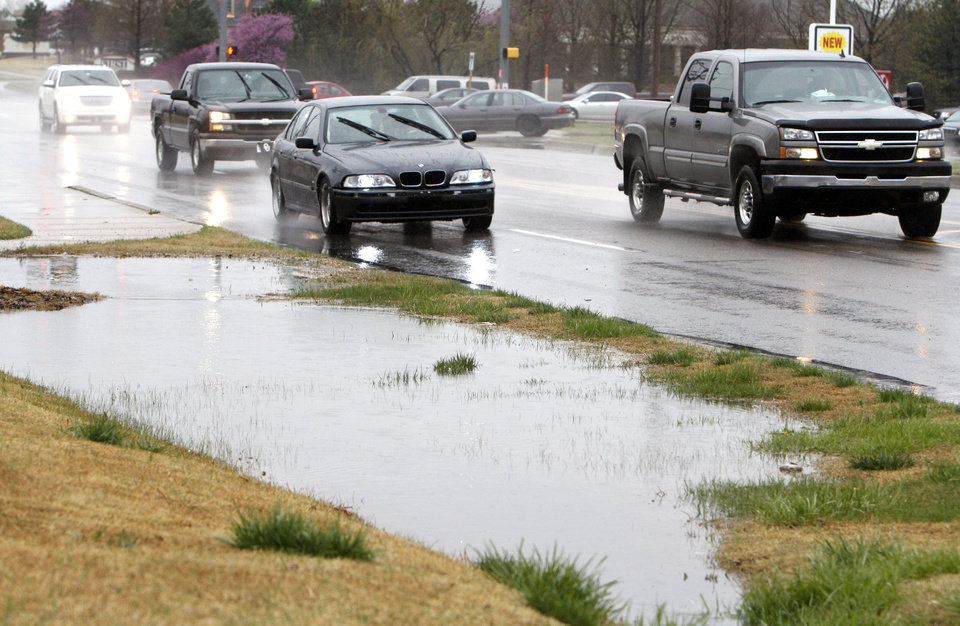 Ditches are filled by runoff from heavy rains in Edmond on Tuesday. By Paul Hellstern, The Oklahoman <strong>PAUL HELLSTERN - Oklahoman</strong>