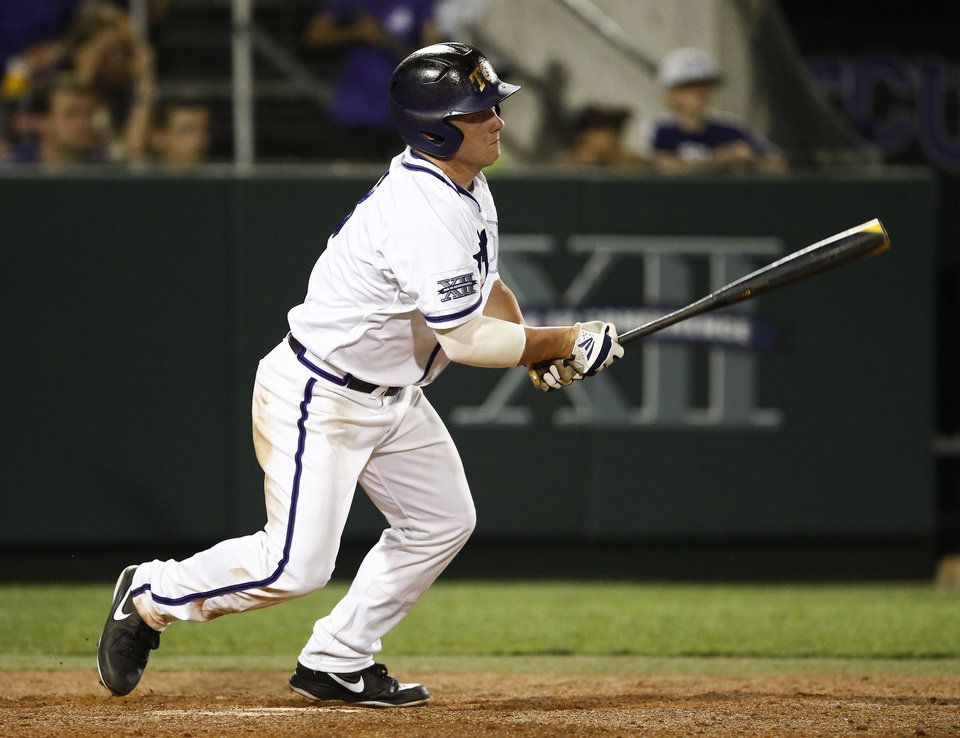 Photo - TCU's Boomer White follows through on his game-winning hit against Siena during the eleventh inning of an NCAA college baseball regional tournament game in Fort Worth, Texas, Friday, May 30, 2014. TCU won in eleven innings 2-1. (AP Photo/Jim Cowsert)