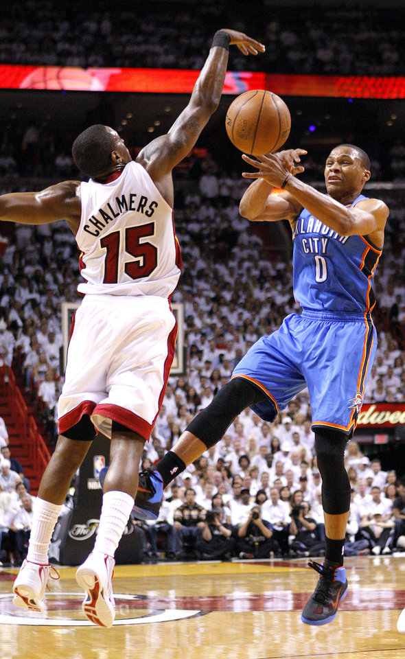 Miami's Mario Chalmers (15) defends against Oklahoma City's Russell Westbrook (0) during Game 5 of the NBA Finals between the Oklahoma City Thunder and the Miami Heat at American Airlines Arena, Thursday, June 21, 2012. Photo by Bryan Terry, The Oklahoman