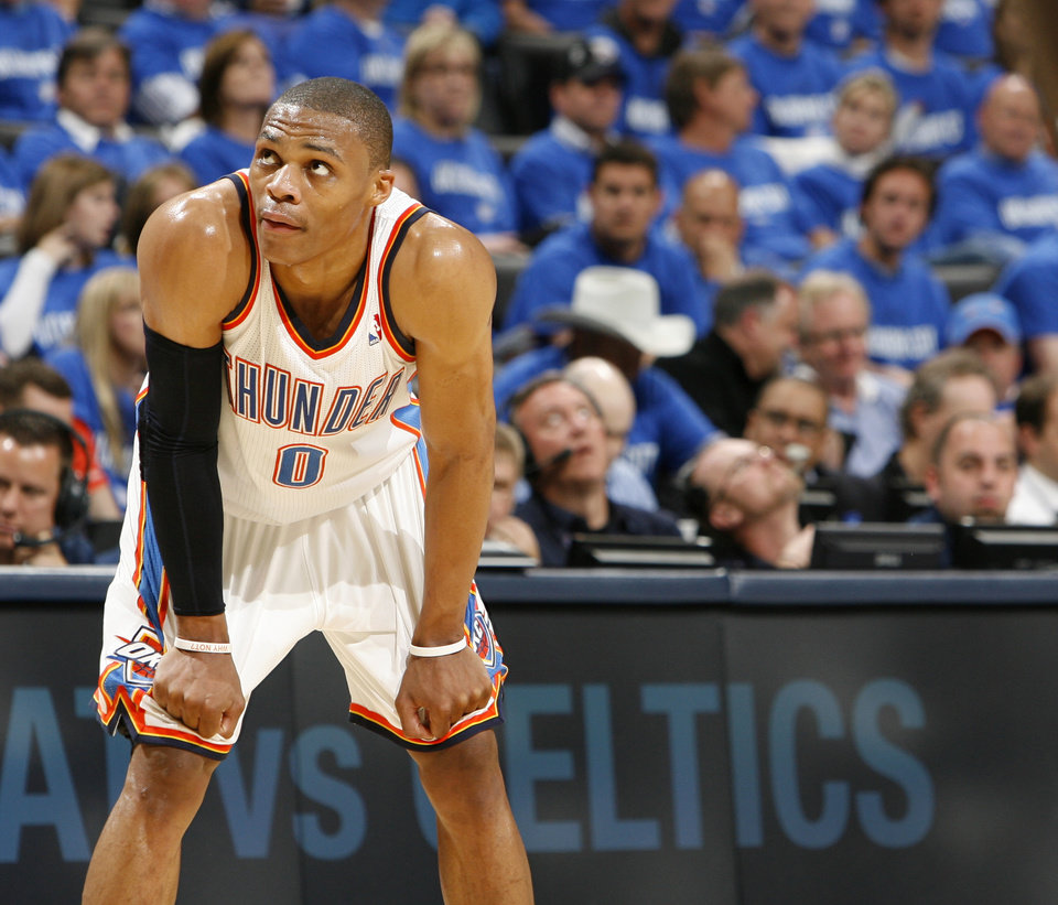 Photo - Oklahoma City's Russell Westbrook (0) rests his hands on his knees as the Grizzlies take foul shots late in the second half during game one of the Western Conference semifinals between the Memphis Grizzlies and the Oklahoma City Thunder in the NBA basketball playoffs at Oklahoma City Arena in Oklahoma City, Sunday, May 1, 2011. Memphis won, 114-101. Photo by Nate Billings, The Oklahoman