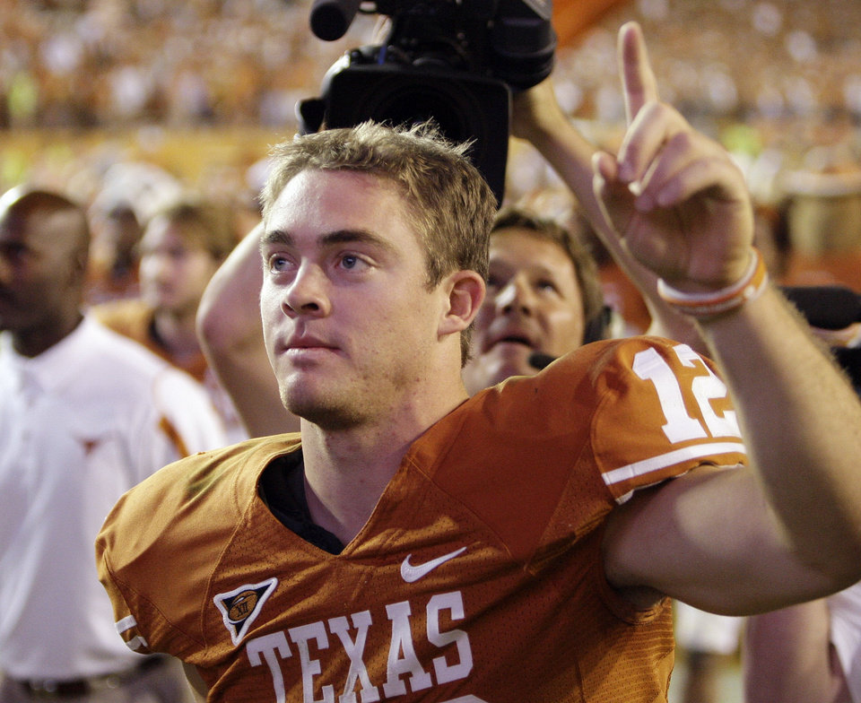 Photo - University of Texas quarterback Colt McCoy walks off the field after the team's NCAA college football game against University of Missouri in Austin, Texas, Saturday, Oct. 18, 2008. Texas won 56-31.  (AP Photo/Harry Cabluck) ORG XMIT: TXEG109