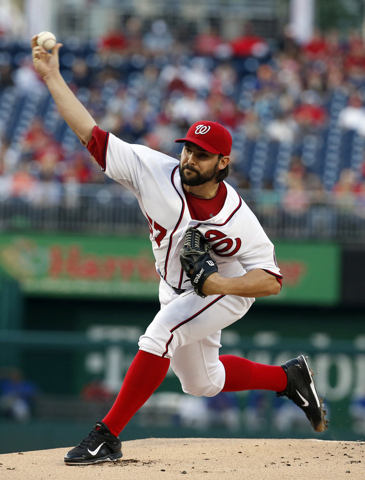 Photo - Washington Nationals starting pitcher Tanner Roark throwS during the first inning of a baseball game against the New York Mets at Nationals Park Friday, May 16, 2014, in Washington. (AP Photo/Alex Brandon)