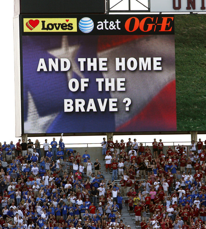 The scoreboard sing-a-long ends the National Anthem with a question mark before the college football game between the University of Oklahoma Sooners (OU) and the Air Force Falcons at Gaylord Family-Oklahoma Memorial Stadium on Saturday, Sept. 18, 2010, in Norman, Okla.   Photo by Steve Sisney, The Oklahoman