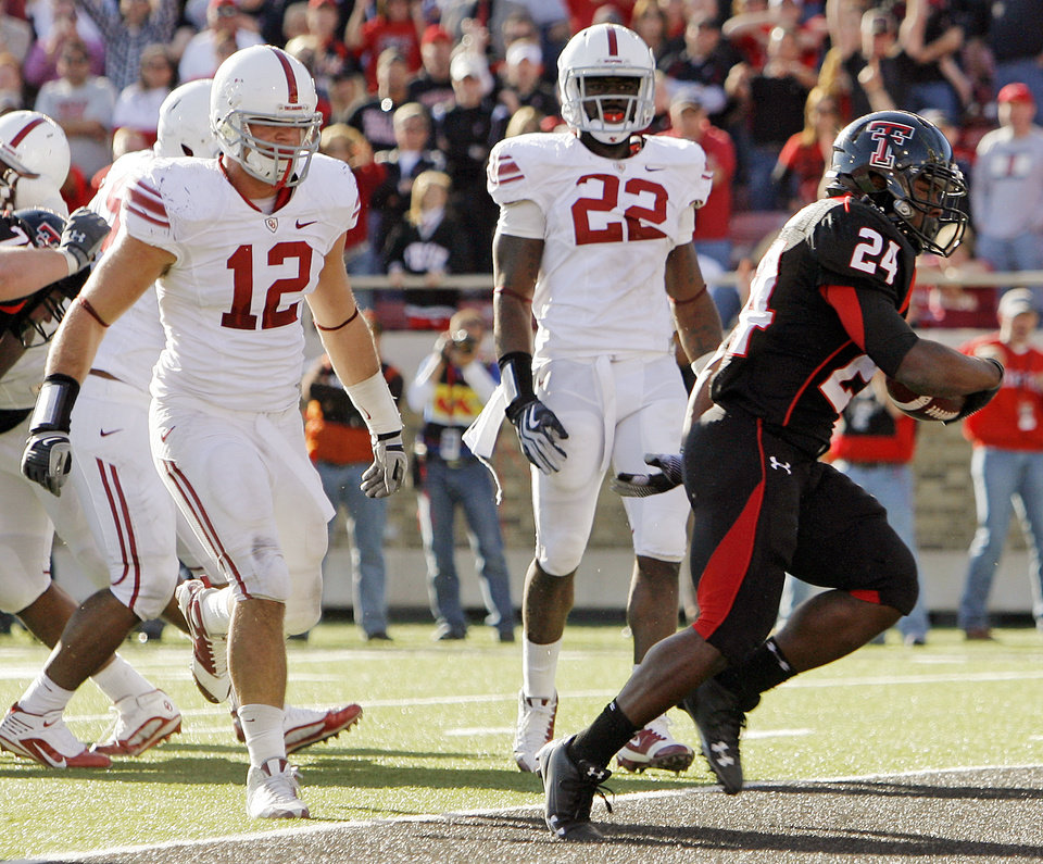 Texas Tech's Eric Stephens (24) rushes for a touchdown in front of OU's Austin Box (12) and Keenan Clayton (22) in the fourth quarter during the college football game between the University of Oklahoma Sooners (OU) and the Texas Tech University Red Raiders (TTU) at Jones AT&T Stadium in Lubbock, Texas, Saturday, Nov. 21, 2009. Texas Tech won, 41-13. Photo by Nate Billings, The Oklahoman