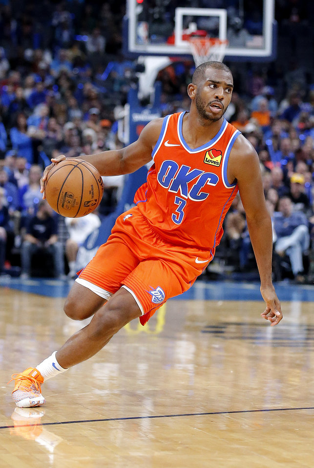 Photo - Oklahoma City's Chris Paul (3) drives up court during the NBA game between the Oklahoma City Thunder and the Milwaukee Bucks at Chesapeake Energy Arena,   Sunday, Nov. 10, 2019.  [Sarah Phipps/The Oklahoman]
