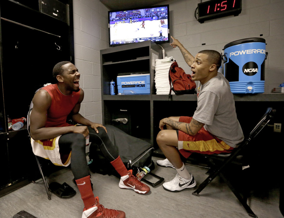 Photo - Iowa State's Dustin Hogue, left, and Sherron Dorsey-Walker, right, watch Texas play Michigan as they sit in their locker room before an NCAA college basketball tournament practice Saturday, March 22, 2014, in San Antonio. Iowa State will play North Carolina Sunday. (AP Photo/David J. Phillip)