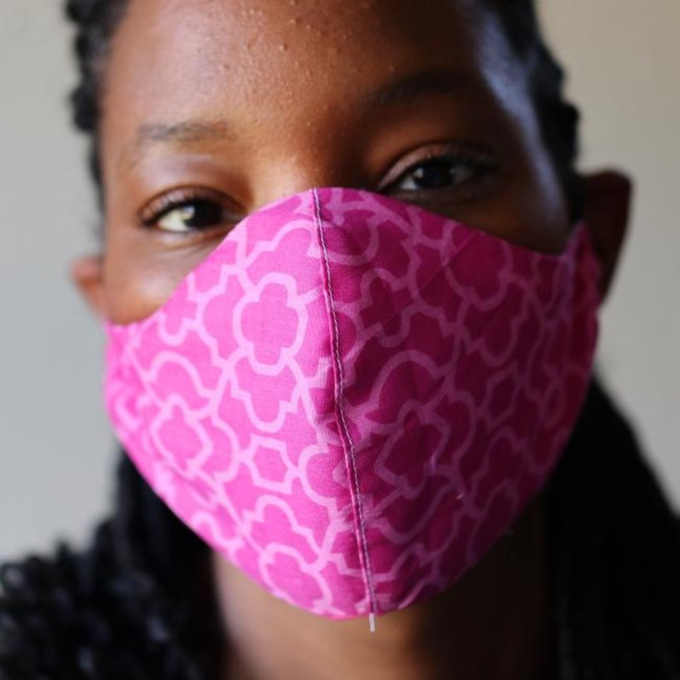 Photo -  Tiffany Cunningham, in Midwest City, who has been making masks all week at home and donating them to nursing homes and hospitals.  Wednesday,  March 25, 2020.  [Photo by Doug Hoke/The Oklahoman]
