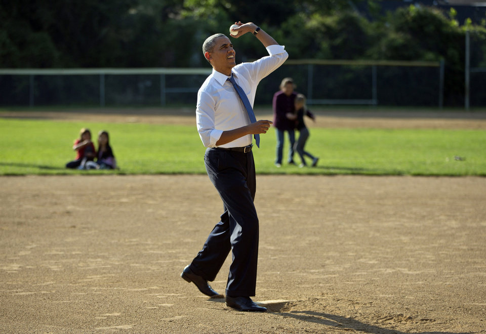 Photo - President Barack Obama makes a unannounced stop to surprise members of the Northwest little league baseball teams at Friendship Park in Washington, Monday, May 19, 2014. Obama stopped to meet with the players before heading off to a private Democratic fundraiser. (AP Photo/Pablo Martinez Monsivais)